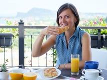 Cheerful woman having breakfast Stock Photo