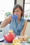 Cheerful woman having  breakfast Stock Photography