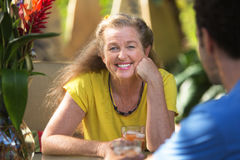 Cheerful Woman Having Drinks with Friend Stock Images