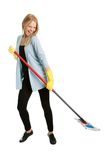 Cheerful woman having fun while cleaning Royalty Free Stock Photos