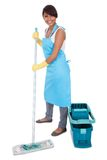 Cheerful woman having fun while cleaning stock photography
