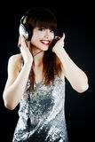 Cheerful woman with headphones Stock Images