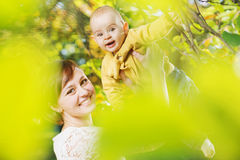 Cheerful woman with her child Stock Photos