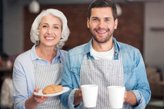 Cheerful woman and her grandson holding welcoming you Royalty Free Stock Photo