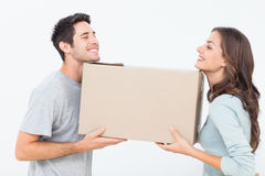 Cheerful woman and her husband holding a box Royalty Free Stock Photo