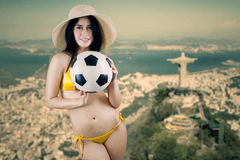 Cheerful woman holding ball in Brazil 1 Stock Image