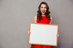 Cheerful woman holding blank board Royalty Free Stock Photos