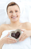 Cheerful woman holding a bowl with chocolate Stock Photos