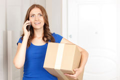 Cheerful woman holding box Royalty Free Stock Photo