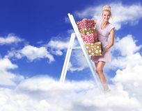 Cheerful lady holding a bunch of gifts - heaven concept royalty free stock photos