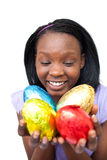 Cheerful woman holding colorful Easter eggs Stock Images