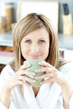 Cheerful woman holding a cup of coffee Stock Photo