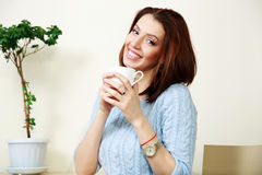 Cheerful woman holding cup with coffee Stock Photography