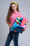 Cheerful woman holding different cleaning stuff Stock Photo