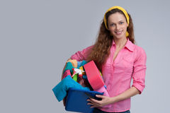 Cheerful woman holding different cleaning stuff Royalty Free Stock Image