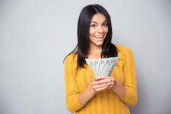 Cheerful woman holding dollar bills Royalty Free Stock Photography