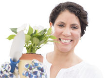 Cheerful Woman Holding Flower Pot And Shovel Royalty Free Stock Image