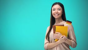 Cheerful woman holding German flag book, education abroad, learning language. Stock footage stock footage