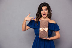 Cheerful woman holding gift box Royalty Free Stock Image