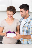 Cheerful woman holding a gift from her partner Royalty Free Stock Photo