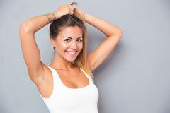 Cheerful woman holding her ponytail Stock Images