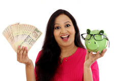Cheerful Woman holding Indian currency notes Stock Image