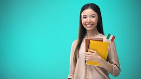 Cheerful woman holding Italian flag book, education abroad, learning language. Stock footage stock video footage
