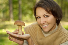 Cheerful woman holding mushroom Royalty Free Stock Photography