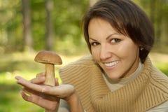 Cheerful woman holding mushroom Royalty Free Stock Photography