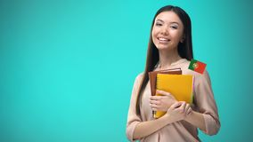 Cheerful woman holding Portuguese flag book, education abroad, learning language. Stock footage stock video