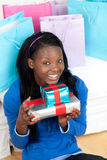 Cheerful woman holding a present Royalty Free Stock Image