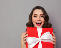 Cheerful woman holding present box Royalty Free Stock Photography