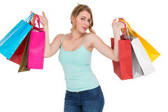 Cheerful woman holding shopping bags. On white background Royalty Free Stock Image