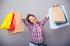 Cheerful woman holding shopping bags Royalty Free Stock Photography