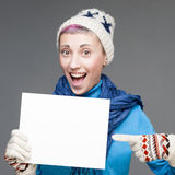 Cheerful woman holding sign on gray background Royalty Free Stock Photography