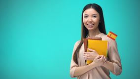 Cheerful woman holding Spanish flag book, education abroad, learning language. Stock footage stock video