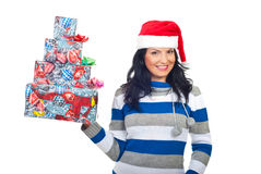 Cheerful woman holding stack of Christmas gifts Stock Photo