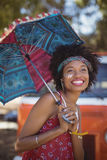 Cheerful woman holding umbrella Royalty Free Stock Photo
