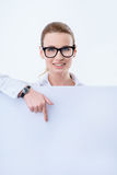 Cheerful woman holding white board stock photos