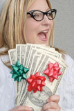 Cheerful woman with Holiday money Stock Photos