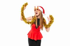 Free Cheerful Woman In Santa Hat And Christmas Glasses Celebrating Ne Royalty Free Stock Photography - 133474017