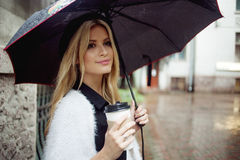 Cheerful Woman In The Street Drinking Morning Coffee Stock Photo
