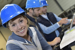 Cheerful woman industrial engineer teamworking Stock Photos