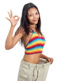 Cheerful woman inside big pants Stock Photo