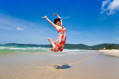 Cheerful woman jumping Stock Photos