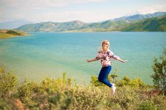 Happy woman jumping outdoors nature. Beautiful summer day Royalty Free Stock Image