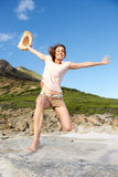 Cheerful woman jumping outdoors Stock Images