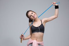 Cheerful woman with jumping rope Stock Photos