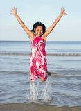 Cheerful woman jumping from the sea Royalty Free Stock Photos
