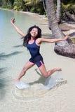 Cheerful woman jumps at sea Royalty Free Stock Image